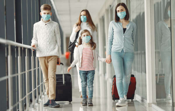 People in airport are wearing masks to protect themselves from v